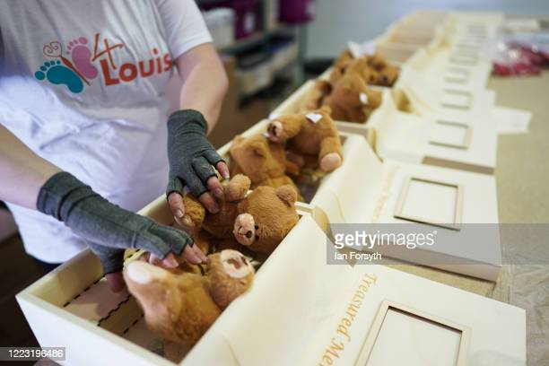 Volunteer Victoria Usher adds teddy bears to memory boxes at the 4Louis charity on May 06 2020 in Sunderland United Kingdom 4Louis provide support to...