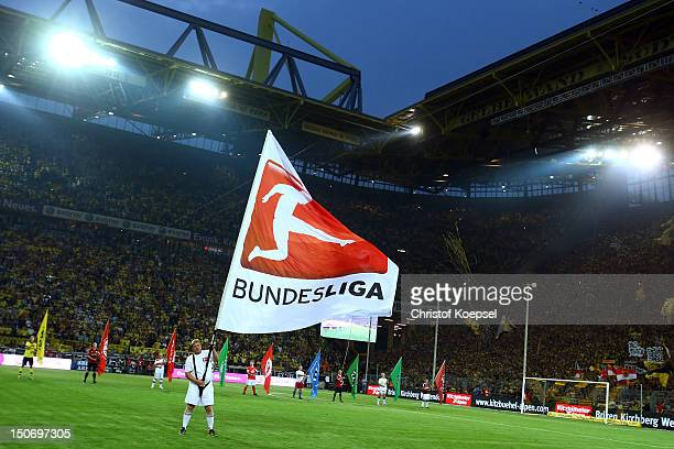 A volunteer waves a flag othe the DFL during the Bundesliga match between Borussia Dortmund and Werder Bremen at Signal Iduna Park on August 24 2012...