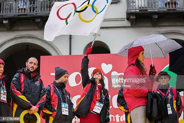 A volunteer waves the flag with Olympic rings during the celebration of 10th year anniversary of the XX Turin Winter Olympic Games