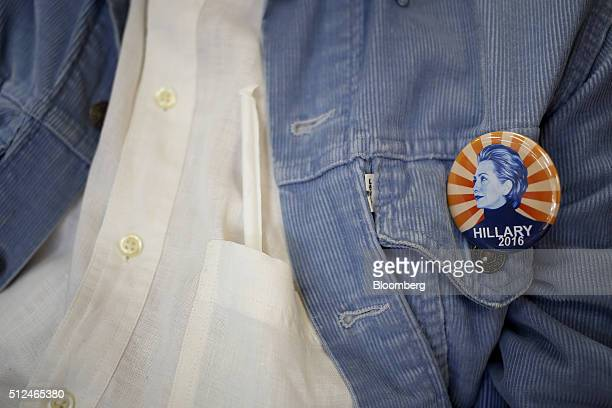 A volunteer wears a Hillary Clinton former Secretary of State and 2016 Democratic presidential candidate button at a campaign field office in...