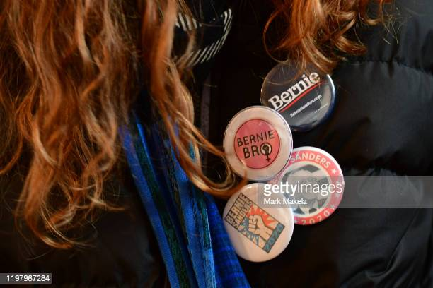Volunteer wears campaign pins supporting Democratic Presidential candidate Bernie Sanders during an event at a field office located in a residence on...