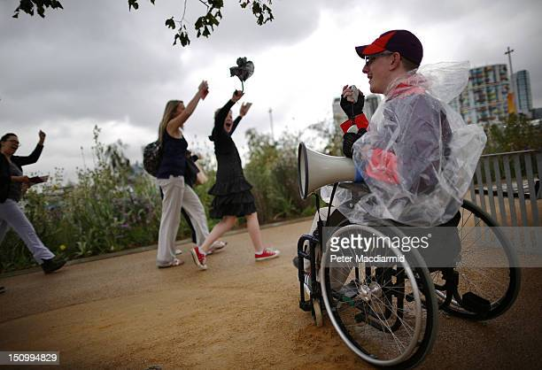 A volunteer welcomes spectators on day 1 of the London 2012 Paralympic Games at The Olympic Park on August 30 2012 in London England The Paralympics...