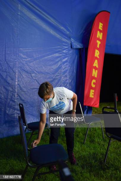 Volunteer wipes down seating in the post vaccination observation area at a new 'Pop Up' vaccination centre in the Big Top of Circus Extreme in...
