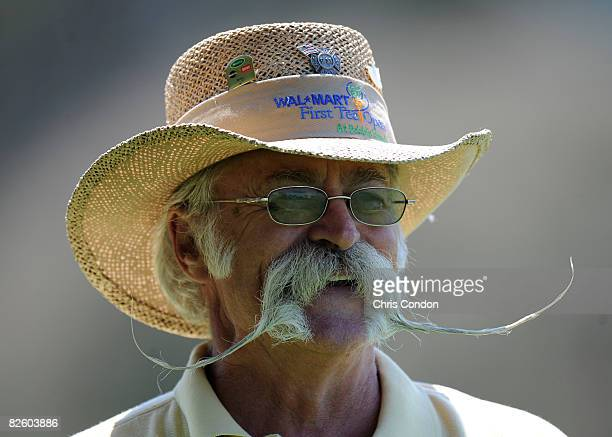 A volunteer with a large handlebar mustache watches play during the first round of the WalMart First Tee Open at Pebble Beach held at Del Monte Golf...
