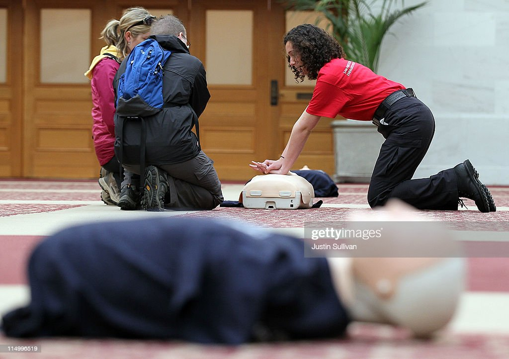 A volunteer with the San Francisco Paramedic Association teaches a couple how to perform CPR using a mannequin on June 1, 2011 in San Francisco, California. The San Francisco Paramedic Association and the American Heart Association kicked off National CPR Week by offering free CPR training to the public.