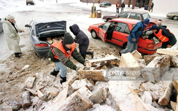 Volunteer worker Patrick Charaoui helps fill the trunk of a Brossard citizen south of Montreal with fire logs 11 January The city of Brossard...
