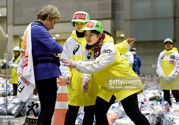 Volunteer workers help a foreign runner after the Tokyo Marathon 2015 at Tokyo Big Sight on February 22 2015 in Tokyo Japan