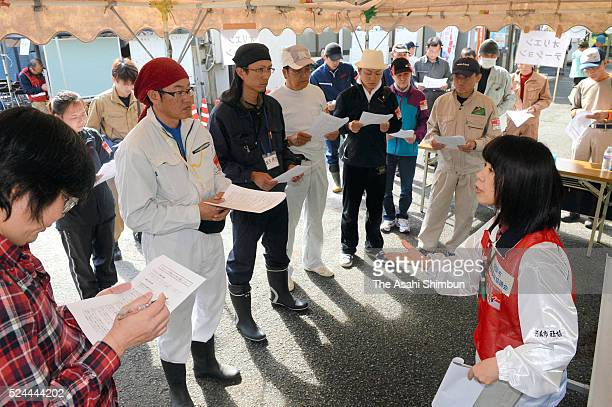 Volunteer workers listen to explanation as the volunteer workers centre opens on April 26, 2016 in Minamiaso, Kumamoto, Japan. 49 people have died by...