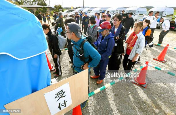 Volunteer workers queue to register a week after the magnitude 67 earthquake on September 13 2018 in Atsuma Hokkaido Japan Concerns are rising about...