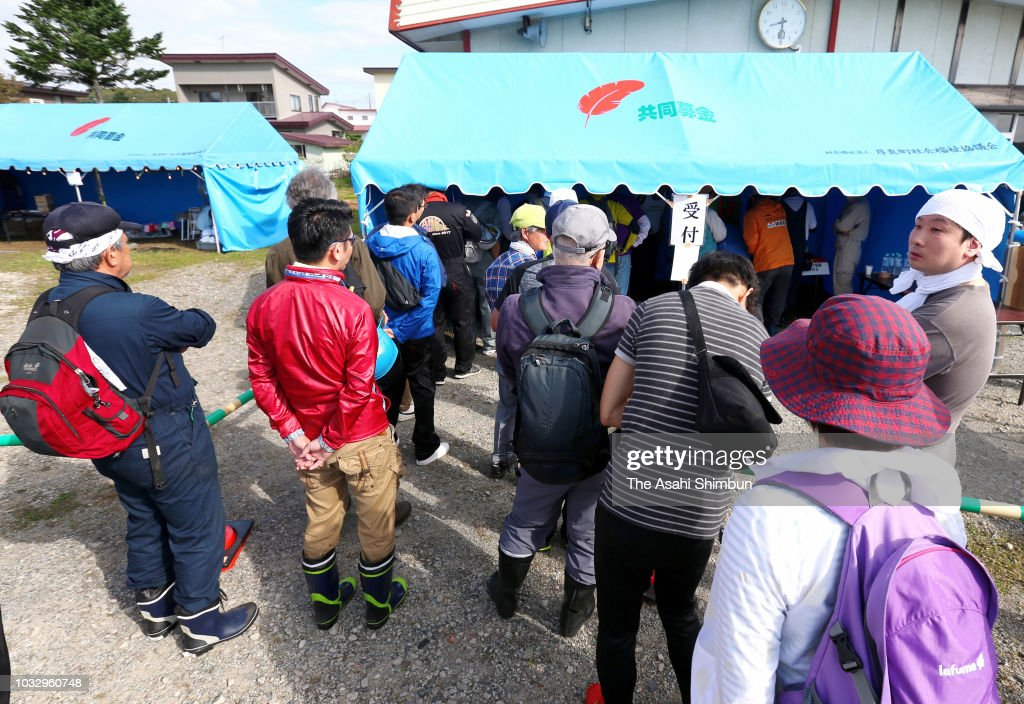 Volunteer workers queue to register a week after the magnitude 6.7 earthquake on September 13, 2018 in Atsuma, Hokkaido, Japan. Concerns are rising about the health of the evacuees because prolonged life in shelters can pose serious risks. Living away from home and together with strangers puts enormous mental and physical strains on evacuees.