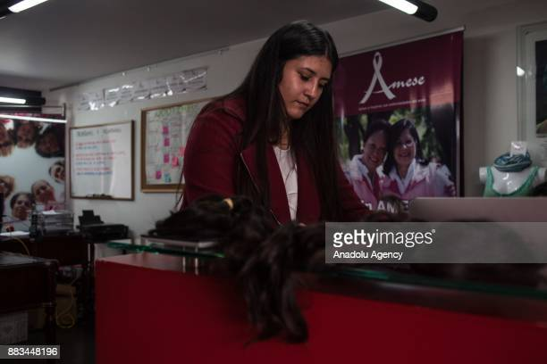 A volunteer working with a hair donation what is going to help to create a new wigs for the essential in dealing with cancer in Bogota Colombia on...