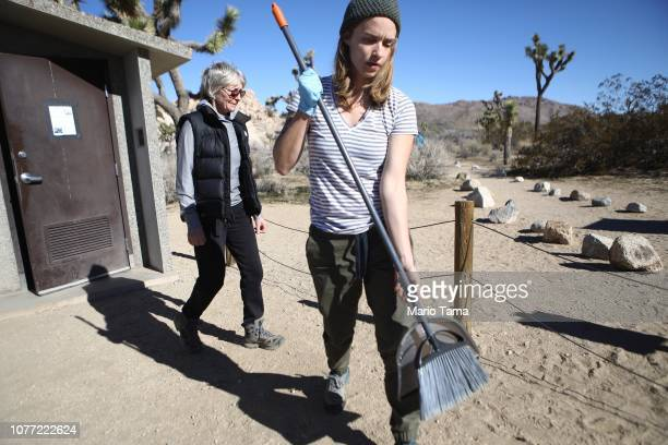 Volunteers Alexandra and Ruth Degen walk after cleaning a restroom at Joshua Tree National Park on January 4 2019 in Joshua Tree National Park...