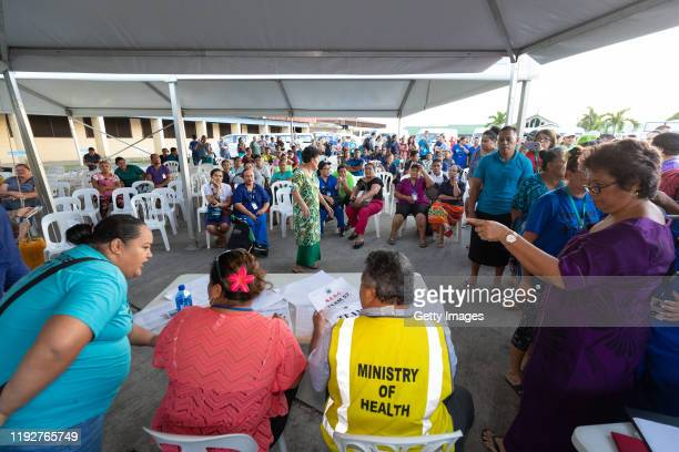 Volunteers and aid workers are assigned to their villages at the National Hospital on December 6 2019 in Apia Samoa Samoan officials report over 90%...