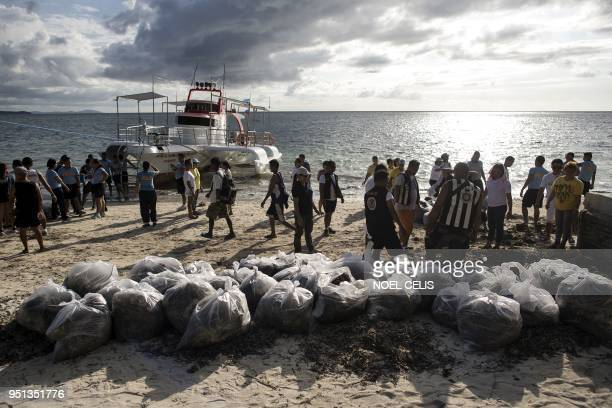 Volunteers and government employees participate in a coastal cleanup on Bulabog beach on the Philippine island of Boracay on April 26 2018 The...