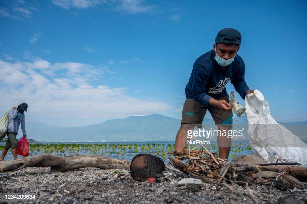 Volunteers and nature lovers pick up plastic waste in a mangrove conservation area on Dupa Beach, Palu Bay, Central Sulawesi Province, Indonesia on...