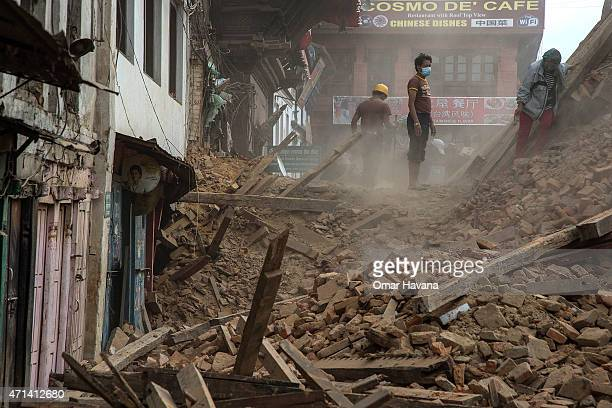 Volunteers and quake emergency team members clear debris from one of the UNESCO World Heritage site temples in Basantapur Durbar Square on April 28,...