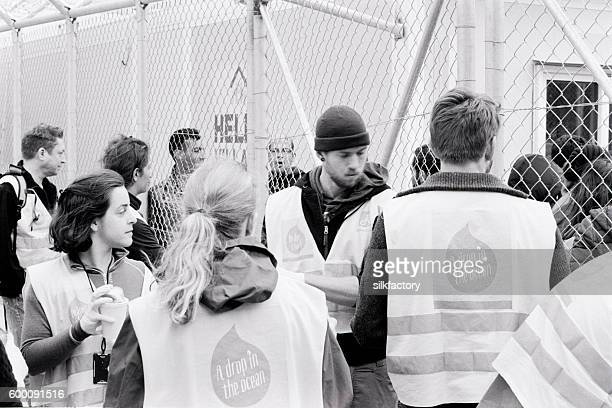 Volunteers and refugee at the Vial Detention Camp on Chios