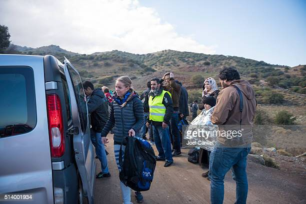 volunteers and refugees on lesbos, greece - humanitarian aid stock pictures, royalty-free photos & images