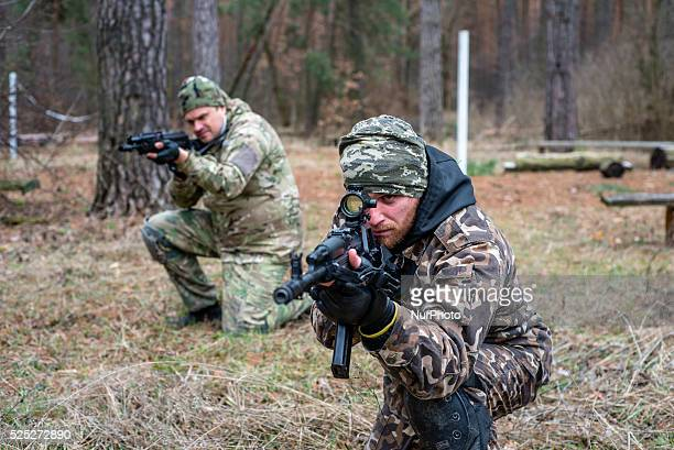 Volunteers and reserve soldiers are learning basics of military stances and moves at training center 'Patriot' Kyiv Ukraine 15 of March 2015