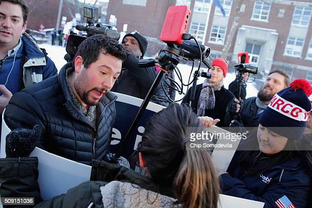 Volunteers and staff for Republican presidential candidate Sen Marco Rubio face off with trackers and demonstrators from the American Bridge 21st...