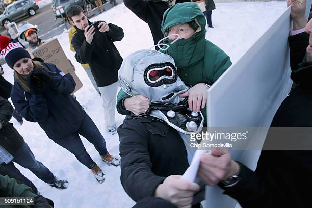 Volunteers and staff for Republican presidential candidate Sen Marco Rubio along with trackers and demonstrators dressed as robots from the American...