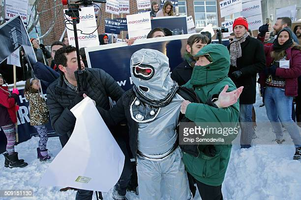 Volunteers and staff for Republican presidential candidate Sen Marco Rubio along with trackers and demonstrators from the American Bridge 21st...
