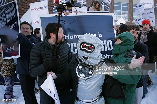 Volunteers and staff for Republican presidential candidate Sen Marco Rubio and trackers and demonstrators dressed as robots from the American Bridge...