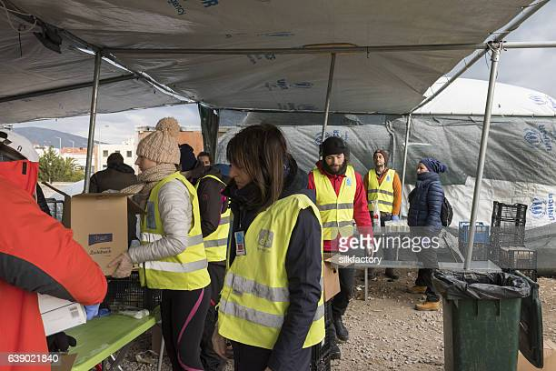 Volunteers are distributing breakfast in Greek refugee camp at Christmas