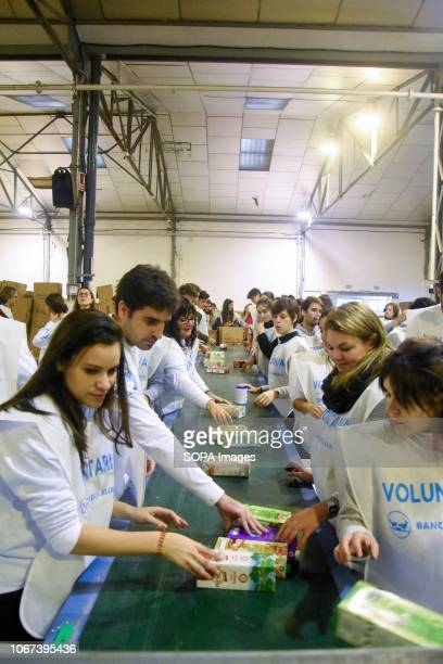 Volunteers are seen sorting food from Food Banks in different provinces at a central warehouse of Barcelona Catalonia Spain The food was sorted by...