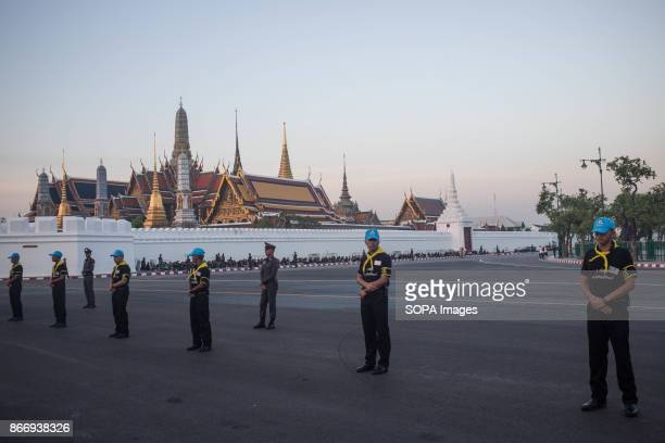 Volunteers are seen standing in front of the Grand Palace as they attend Thailand's Late King Bhumibol Adulyadej's ashes and relics to be taken to...