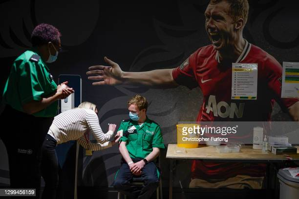 Volunteers are trained by St John Ambulance instructors to administer Covid-19 vaccines at Manchester United Football Club on January 30, 2021 in...