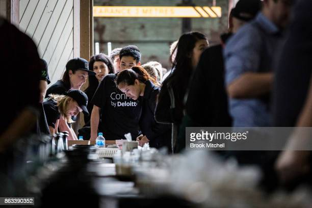Volunteers arrive for Zambrero's meal packing day on October 20 2017 in Sydney Australia More than 1700 volunteers across Australia come together on...