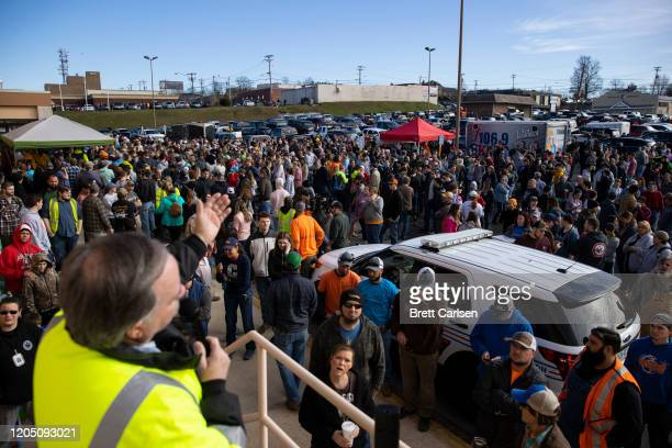 Volunteers assemble to help with tornado cleanup efforts in Putnam County Tennessee on March 4 2020 in Cookeville Tennessee A tornado passed through...