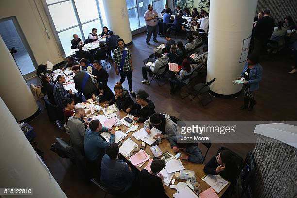 Volunteers assist immigrants with US citizenship applications at a Citizenship Now event held by the City University of New York on March 12 2016 in...