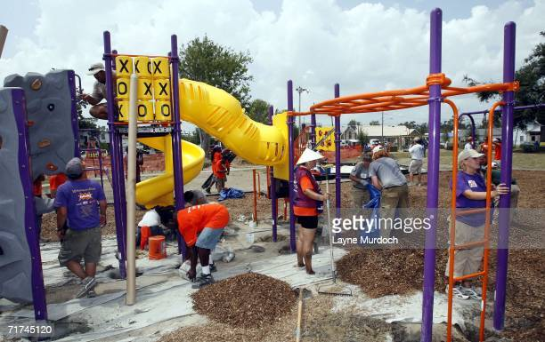 Volunteers assist in the rebuilding of Beck Park to commemorate the one year anniversary of Hurricane Katrina on August 29 2006 in Biloxi Mississippi...