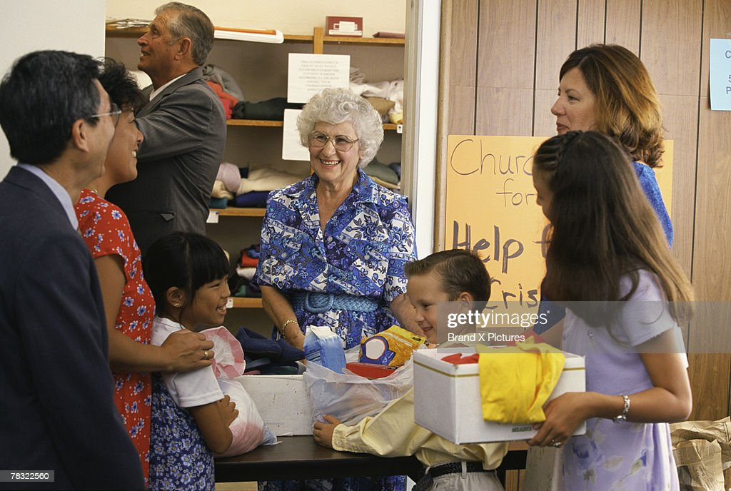 Volunteers at church giving donations : Stock Photo