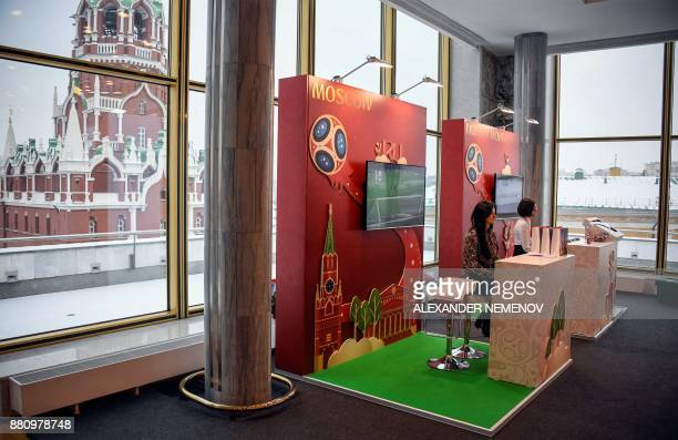 Volunteers at the FIFA World Cup 2018 Final Draw media centre at the State Kremlin Palace in downtown Moscow on November 28 2017 / AFP PHOTO /...