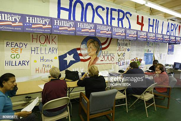 Volunteers at the local campaign office of US Democratic presidential hopeful New York Senator Hillary Clinton call voters to remind them to vote in...