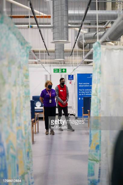 Volunteers at the NHS Nightingale North East hospital assist patients on January 26, 2021 in Sunderland, England. The 460-bed hospital was created in...