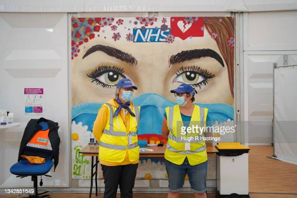 Volunteers at the Stithians Showground temporary NHS vaccination centre during its final hour of opening on September 26, 2021 in Stithians, near...