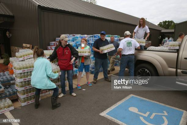 Volunteers at the Vilonia Church of Christ load up supplies for tornado victims April 30 2014 in Vilonia ArkansasDeadly tornadoes ripped through the...