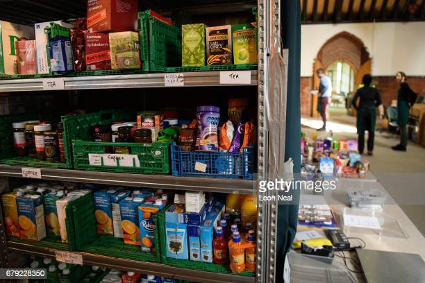 Volunteers at Wandsworth foodbank prepare parcels for guests from their stores of donated food toiletries and other items on May 5 2017 in London...