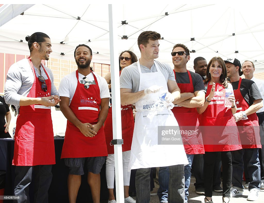 Volunteers attend the annual Police And Fire BBQ on August 27, 2014 in Hollywood, California.
