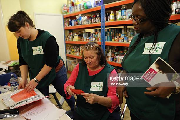 Volunteers begin to process a food voucher at a Food Bank depot at St Paul's Church in Brixton on October 23 2012 in London England The need for food...