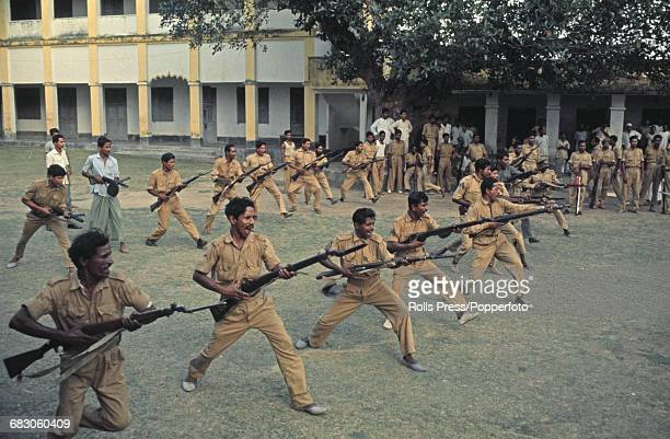 View of volunteers being drilled by soldiers of the East Pakistan Rifles inside the Chuadanga barracks in preparation for fighting in the Bangladesh...
