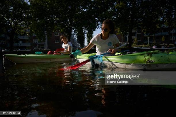 Volunteers belonging to an NGO navigate with kayaks through the canals removing rubbish from the water during World Cleanup Day on September 19 2020...