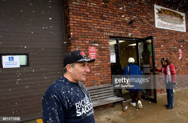 Volunteers Bernie DeMaio left and his wife Lesa right greet voters showing up to place their ballots in a special election between Democratic...