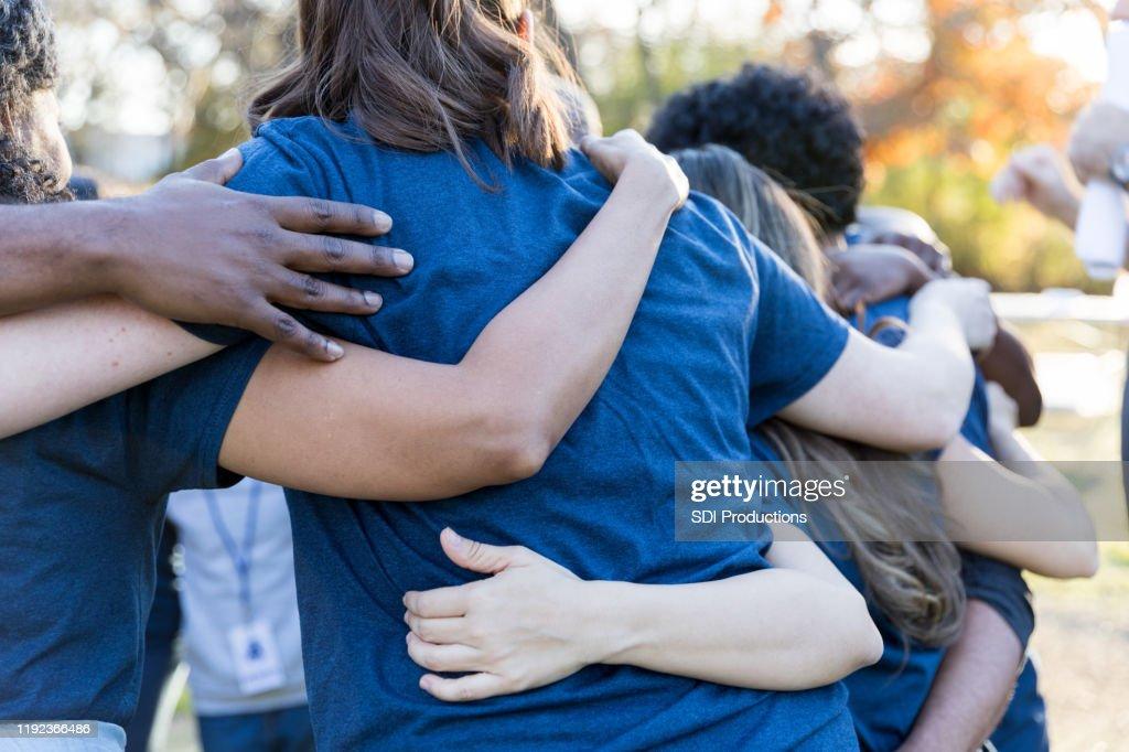 Volunteers bonding during charity event : Stock Photo