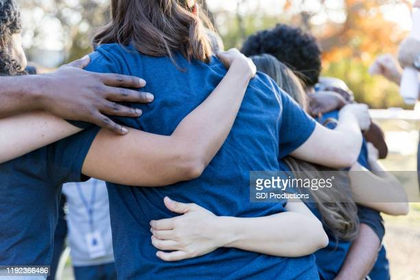 volunteers bonding during charity event - non profit organization stock pictures, royalty-free photos & images