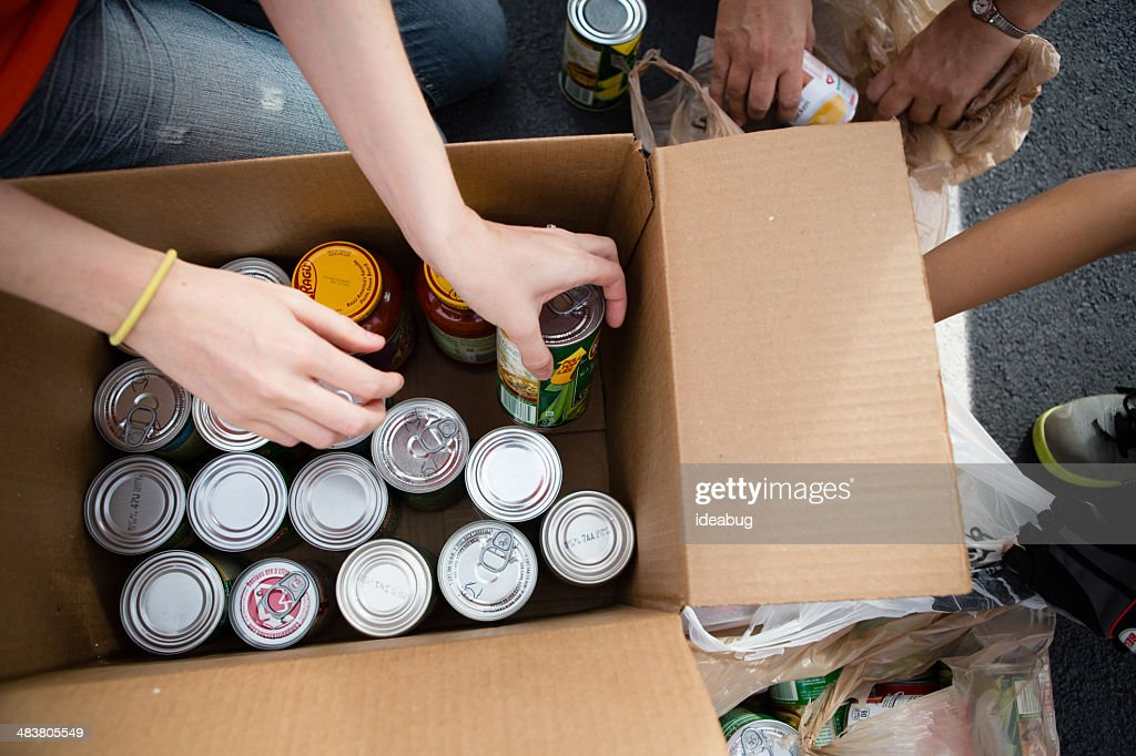 Volunteers Boxing Cans at Food Drive : Stock Photo